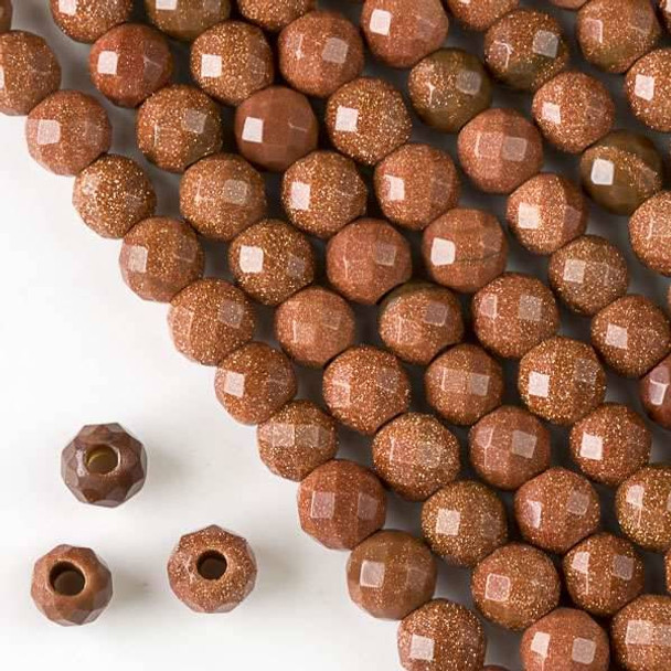 Faceted Large Hole Goldstone 8mm Round with a 2.5mm Drilled Hole - approx. 8 inch strand