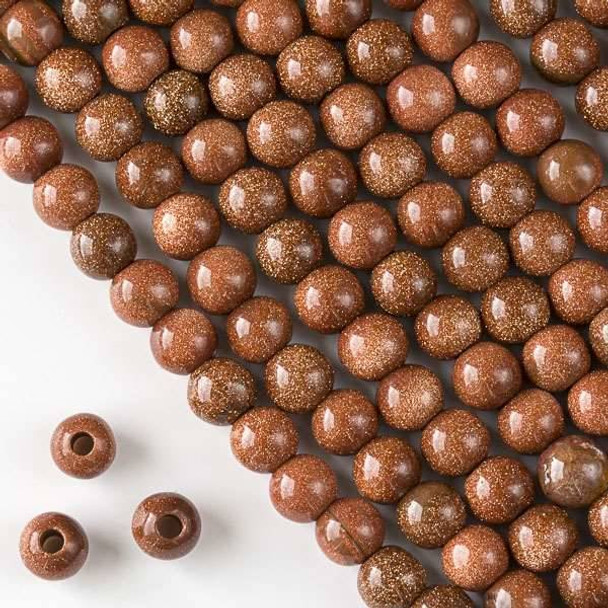 Large Hole Goldstone 8mm Round with 2.5mm Drilled Hole - approx. 8 inch strand