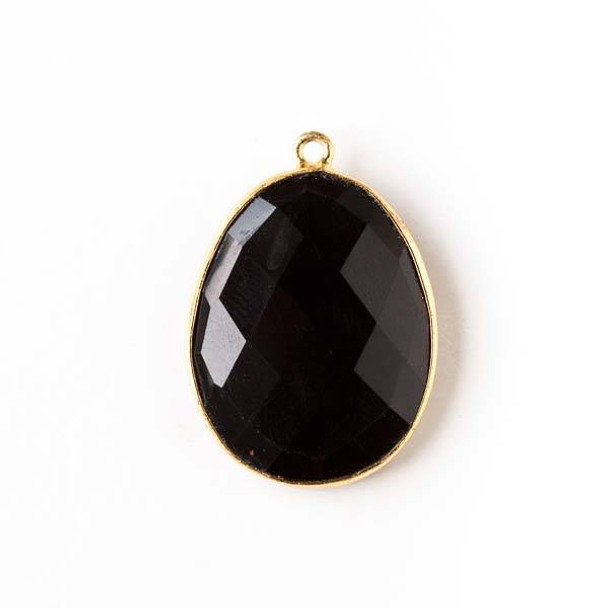 Onyx 19x27mm Oval Drop with a Gold Plated Brass Bezel
