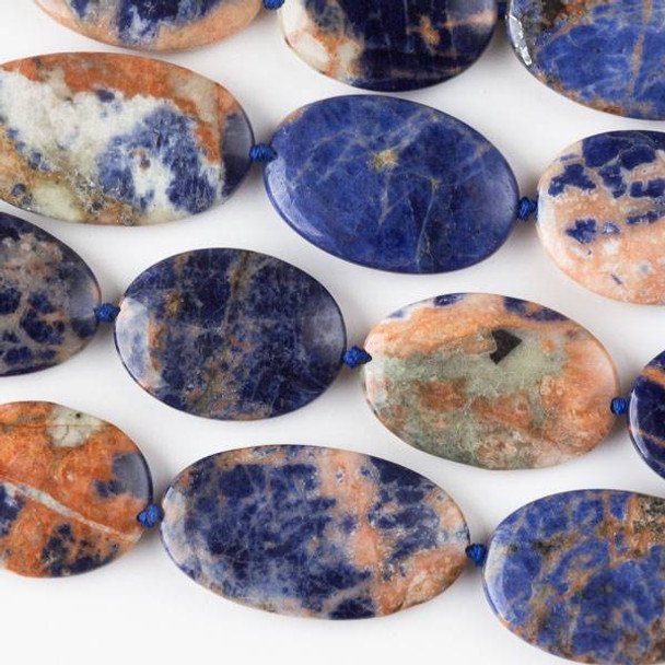 Orange Sodalite 20x35mm, 20x30mm, and 20x26mm Oval Mix - 16 inch strand
