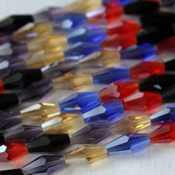 Glass Crystal 6x12mm Long Bicone Alternating Blue, Citrine, Lilac, Lt. Siam, and Jet - 8 Inch Strand