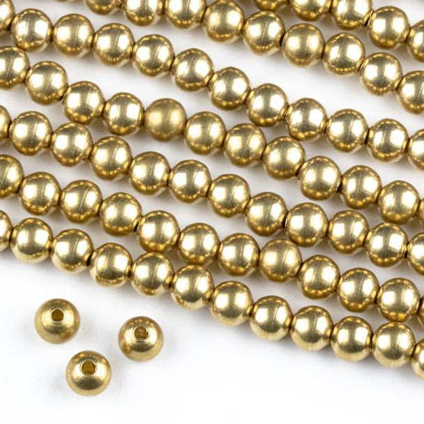 Raw Brass 5mm Round Beads with approximately 1.75mm Large Hole - approx. 8 inch strand
