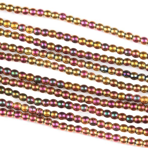 Hematite 2mm Electroplated Fuchsia Rainbow Round Beads - approx. 8 inch strand