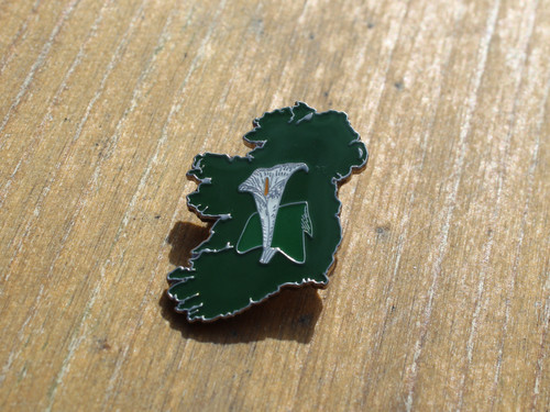 Map of Ireland with an easter lily at it's centre enamel badge