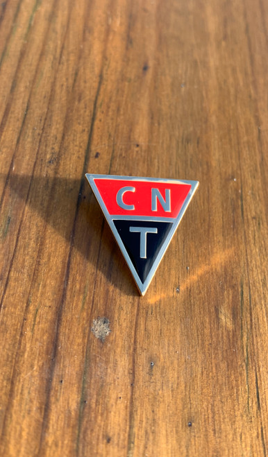 Reproduction CNT enamel badge 24.8mm x 25 mm with brooch fixing.