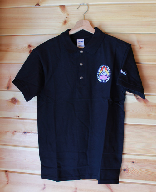 Black gildan polo shirt with embroidered International Brigade badge on left breast.