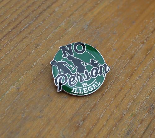 No Person Is Illegal enamel badge