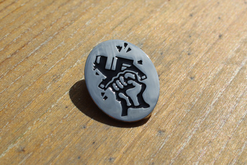 Smash Fascism metal badge on a silver background