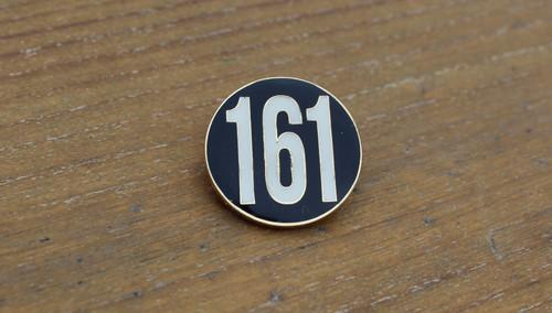 161 black enamel badge
