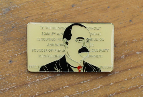 James Connolly enamel badge with the plaque to his memory at Cowgate as a backdrop.