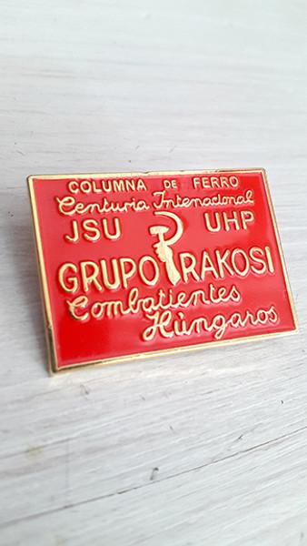 Badge has brooch fixing with the following text:  COLUMNA de FERRO Centuria Internacional JSU UHP GRUPO RAKOSI Combatientes Hungaros