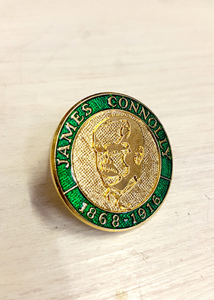 Irish Republican Socialist collection  2D image of Edinburgh born, Irish Republican Socialist James Connolly on an enamel badge with brooch fixing.  Badge reads: JAMES CONNOLLY 1868-1916