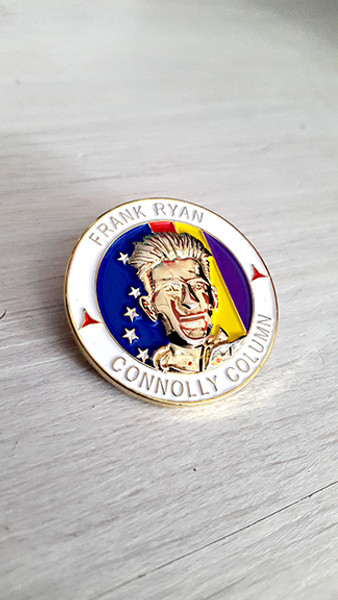 This badge has the text FRANK RYAN, CONNOLLY COLUMN, with two small International Brigade stars and a 3D image of Ryan from a picture taken during the Spanish civil war over the background of a Starry Plough and Spanish Republican flag.
