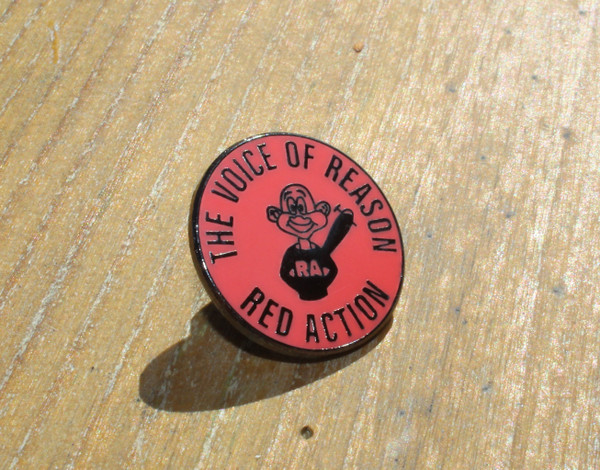 Red Action enamel badge