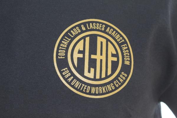 Football Lads & Lasses Against Fascism black t-shirt with FLAF logo left breast screen print.