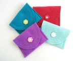 light blue, purple, turquoise, and red travel cases