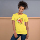 """Front view of yellow """"Watch Yourself Bloom"""" Relaxed Fit T-Shirt with pink and yellow bi-color rose and black text"""