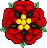Graphic from bottle label: Illustration of a red symmetrical flower