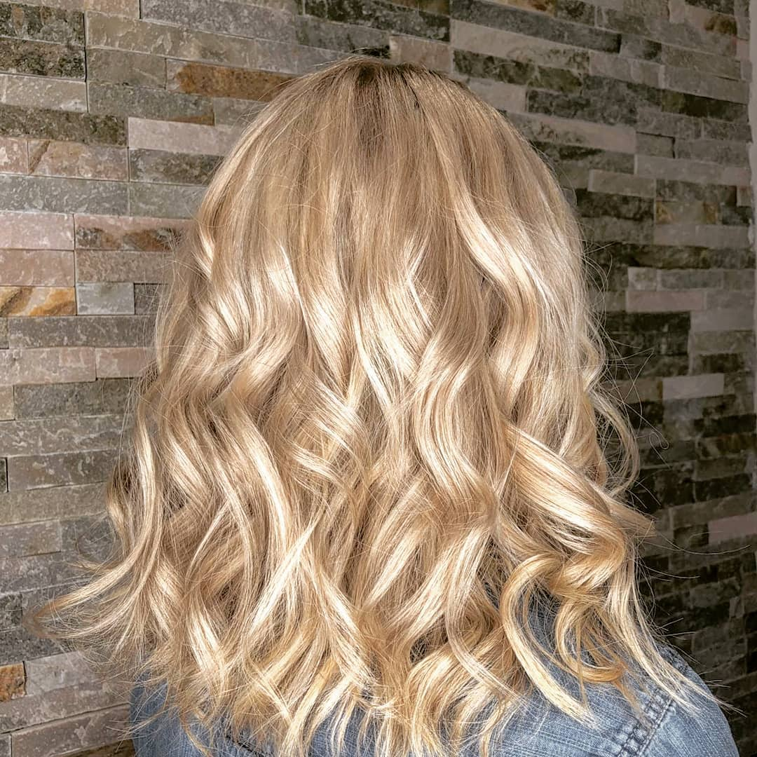 Lovely soft blonde curly lob