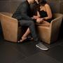 Moxie Wearable Clitoral Stimulator (Black) lifestyle image of couple sitting closely