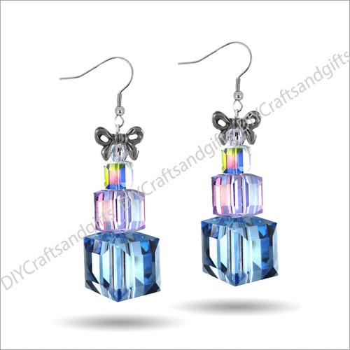 Beautiful Handmade Swarovski Crystal Earrings. The perfect gift for Christmas! Choose between Silver Plated, Gold Plated, Sterling Silver and 9ct Yellow Gold findings. These presents have Bow on the top (gold or silver - matching the findings), a Crystal bicone, small CrystalAB present, medium Violet (purple) present, and a large Light Sapphire (blue) present. Approx. 27mm long & 19mm wide at top of bow.