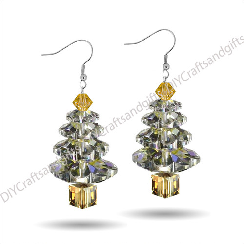 Beautiful Handmade Swarovski Crystal Earrings. The perfect gift for Christmas! Choose between Silver Plated, Gold Plated, Sterling Silver and 9ct Yellow Gold findings. This tree has a Gold top, Crystal leaves, and a Gold trunk. Approx. 25mm long & 11mm wide