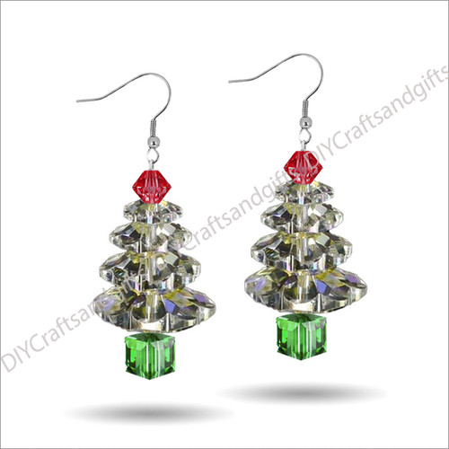 Beautiful Handmade Swarovski Crystal Earrings. The perfect gift for Christmas! Choose between Silver Plated, Gold Plated, Sterling Silver and 9ct Yellow Gold findings.This tree has a Light Siam (red) top, Crystal leaves, and a Peridot (green) trunk.Approx. 25mm long & 10mm wide