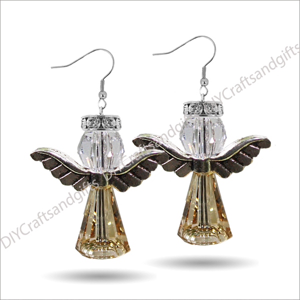 Beautiful Handmade Swarovski Crystal Earrings. The perfect gift for Christmas! Choose between Silver Plated, Gold Plated, Sterling Silver and 9ct Yellow Gold findings.This Angel has a Silver Crystal halo, CrystalAB head, Silver wings, and a Gold bottom. (Note, the Crystal Halo is not a Swarovski product) Approx. 27mm long & 26mm wide at the wings