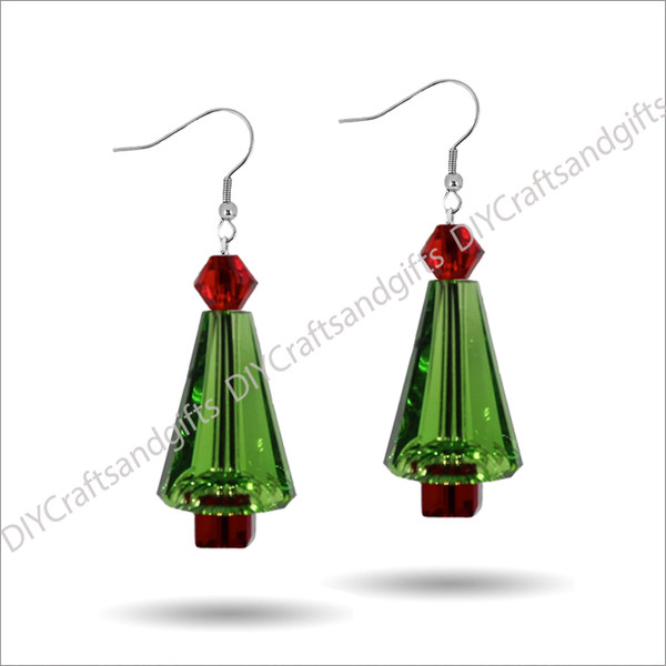 Beautiful Handmade Swarovski Crystal Earrings. The perfect gift for Christmas! Choose between Silver Plated, Gold Plated, Sterling Silver and 9ct Yellow Gold findings. This tree has a Light Siam (red) top, Peridot (green) leaves, and a Siam (red) trunk.