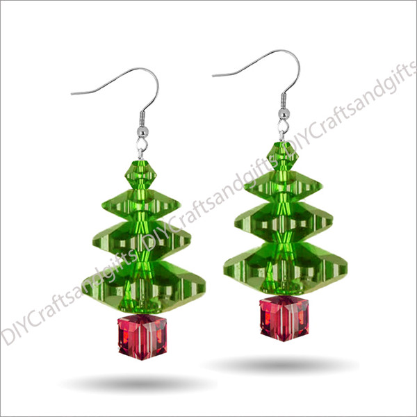Beautiful Handmade Swarovski Crystal Earrings. The perfect gift for Christmas! Choose between Silver Plated, Gold Plated, Sterling Silver and 9ct Yellow Gold findings. This tree has a Peridot (green) top, Peridot (green) leaves, and a Siam (red) trunk. Approx. 17mm long & 10mm wide