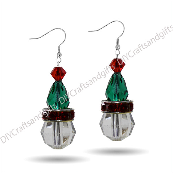 Beautiful Handmade Swarovski Crystal Earrings. The perfect gift for Christmas! Choose between Silver Plated, Gold Plated, Sterling Silver and 9ct Yellow Gold findings. This hat has a Light Siam (red) top, EmeraldAB (green) hat, Red band, and a CrystalAB head. (Note, the Crystal band is not a Swarovski product)  Approx. 25mm long & 10mm wide