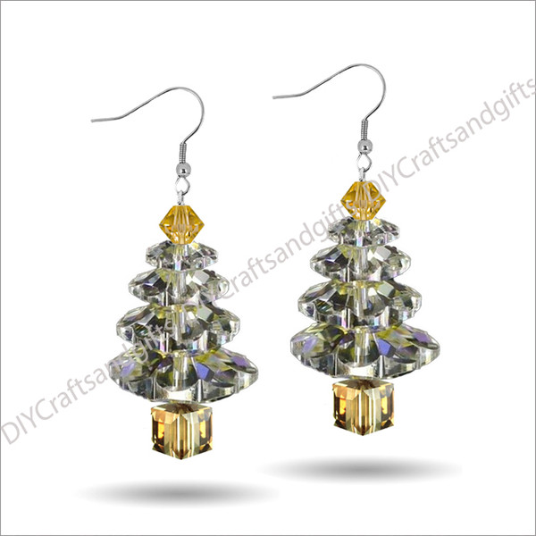 Beautiful Handmade Swarovski Crystal Earrings. The perfect gift for Christmas! Choose between Silver Plated, Gold Plated, Sterling Silver and 9ct Yellow Gold findings.This tree has a Gold top, Crystal leaves, and a Gold trunk.Approx. 25mm long & 11mm wide