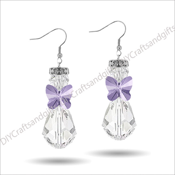 Beautiful Handmade Swarovski Crystal Earrings. The perfect gift for Christmas! Choose between Silver Plated, Gold Plated, Sterling Silver and 9ct Yellow Gold findings. This Angel has a Crystal halo, Crystal head, Violet Butterfly wings, and a Crystal bottom. (Note, the Crystal Halo is not a Swarovski product) Approx. 25mm long & 10mm wide