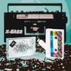 Lifestyle image of cassette flash drive and case against ribbon and 90s 80s boombox background