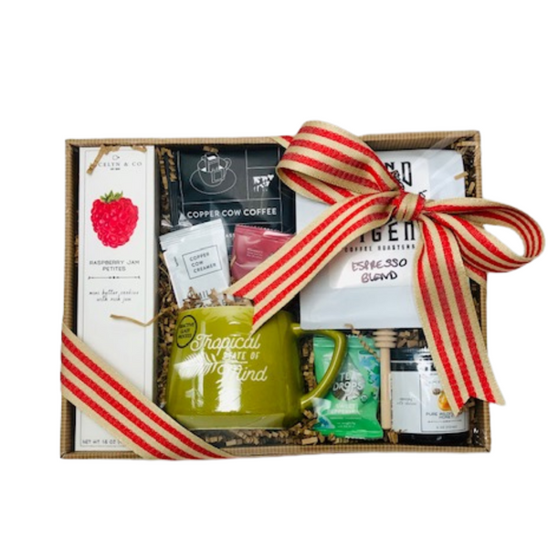 Coffee and Tea Lovers will absolutely enjoy the sampling in this gift.  It includes 1Lb of our local brand Blind Tiger coffee Roasters, Copper Cow pour over Vietnamese coffee with creamer, Jocelyn & co. pure wildflower honey, Tea Drops dissolvable loose leaf tea, Raspberry Jam Petite cookies and a Tropical State of Mind Mug.