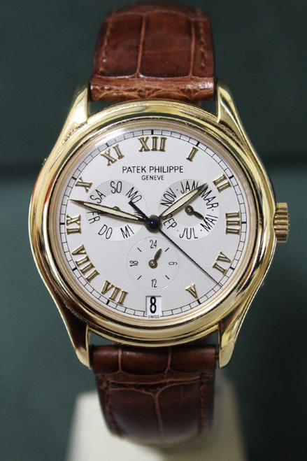 Patek Philippe Annual Calendar - 37mm - Yellow Gold - Ivory Roman Dial - Brown Leather Strap - Ref. 5035