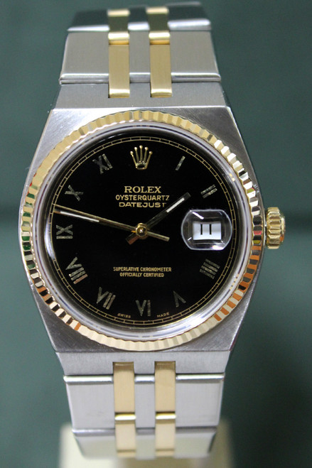 Rolex Oyster Perpetual Datejust Quartz - 36mm - Two-Tone - Yellow Gold Fluted Bezel - Black Roman Dial - Two-Tone Stainless Steel And Yellow Gold Bracelet - Ref. 17013