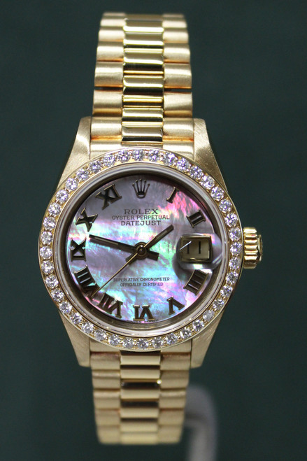 Rolex Oyster Perpetual Ladies Datejust - 26mm - Yellow Gold - Factory Diamond Bezel - Factory Dark Mother Of Pearl Dial - Yellow Gold President Bracelet - Ref. 69178