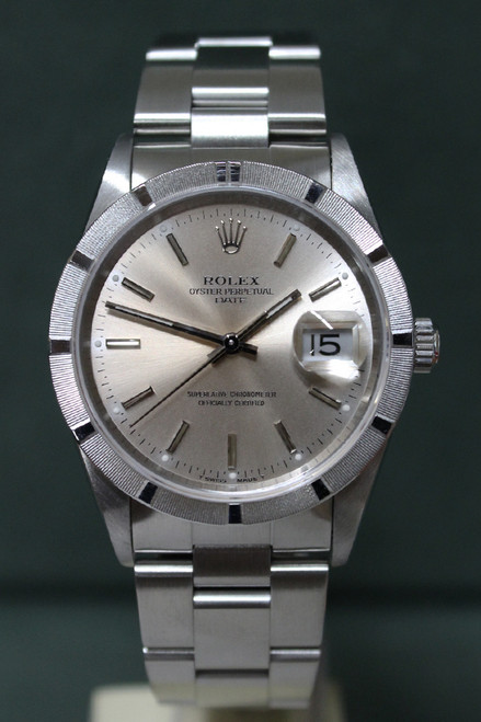 Rolex Oyster Perpetual Date - 34mm - Stainless Steel - Engine Turn Bezel - Silver Stick Dial - Oyster Bracelet - Ref. 15210