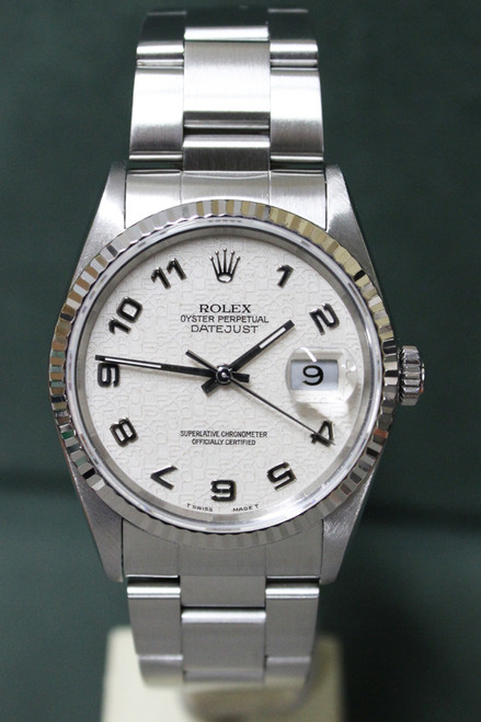 Rolex Oyster Perpetual Datejust - 36mm - Stainless Steel - Fluted Bezel - Off White Anniversary Arabic Dial - Stainless Steel Oyster Bracelet - Ref. 16234