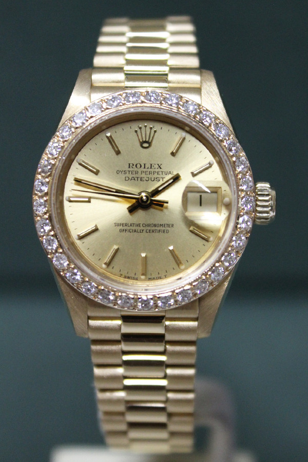Rolex Oyster Perpetual Ladies Datejust - 26mm - Yellow Gold - Diamond Bezel - Champagne Stick Dial - President Bracelet - Ref. 69178
