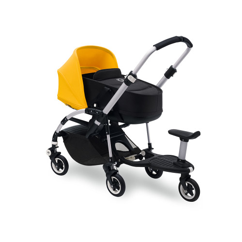 (attached to pushchair with bassinet