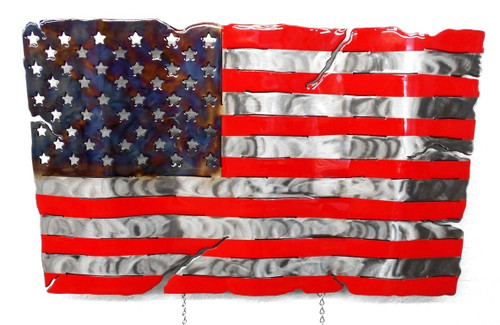"""Our countries flag forged in steel.Each sculpture is cut from 1/8 inch steel plate and then hand polished.It is then heat treated and painted for color before finally being finished with a poured on epoxy coating.Because each sculpture is hand made no two are alike.Each sculpture comes with welded on hardware for hanging and 2 inch offsets which gives the sculpture a floating appearance.Hooks for the optional laser engraved black name plate (40.00) are already installed.Dimensions:23""""W x 14""""H x 2""""D     For custom Name Plates, you have two options:  1) Attach custom note EXACTLY as you want it in the Comments section at the end of your order  2) Email custom note and any logo you want attached to ironworks68@netzero.net"""
