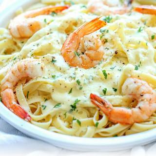 A creamy dish of shrimp, noodles & Alfredo sauce.