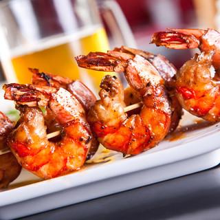 Spot prawns on skewers glazed with gingered teriyaki sauce