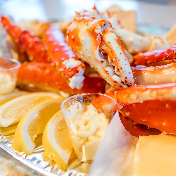 Alaska Red King Crab Legs with lemons & butter.
