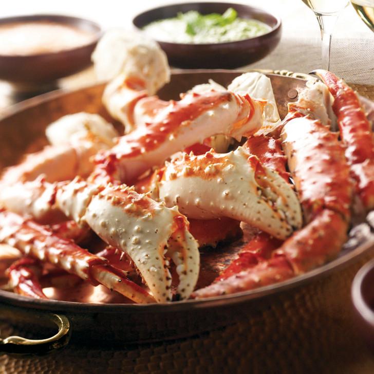 Alaska Red King Crab Legs in brown bowl.