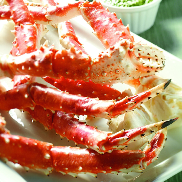 Alaska Red King Crab Legs with dipping sauce.