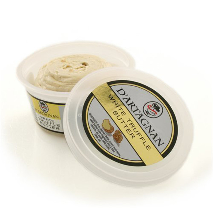 An opened tub of D'Artagnan white truffle butter.