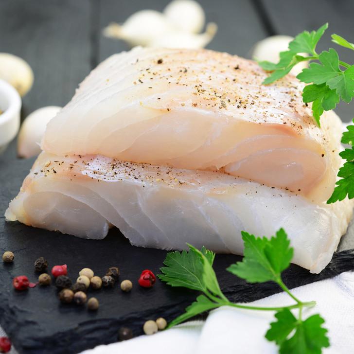 Two stacked portions of fresh Alaska halibut fillet.